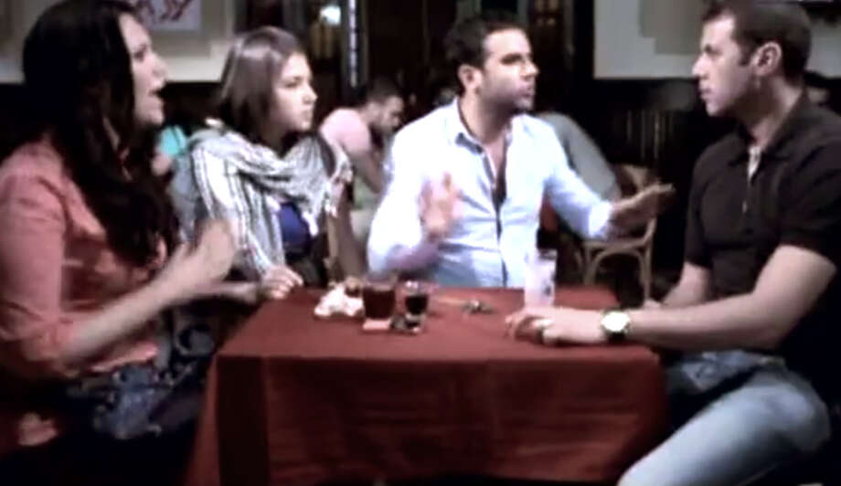 In this image made from video released by the Egyptian State TV and accessed Sunday, June 10, 2012, shows an actor portraying a foreigner, left, who is listening to three actors portraying Egyptians during a scene in a public service announcement in Cairo, Egypt. An Egyptian media official says authorities have pulled TV public service announcements that warned against talking to foreigners who may be spies after criticism that they fueled xenophobia. (AP Photo/Egyptian State TV via AP video) TV OUT, THE ASSOCIATED PRESS CANNOT INDEPENDENTLY VERIFY THE CONTENT, DATE, LOCATION OR AUTHENTICITY OF THIS MATERIAL Photo: Anonymous / Egyptian State TV