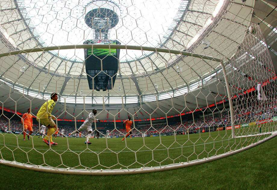 VANCOUVER, CANADA - JUNE 10:  Darren Mattocks #22 of the Vancouver Whitecaps FC scores against Tally Hall #1 of the Houston Dynamo during their MLS game June 10, 2012 in Vancouver, British Columbia, Canada. Photo: Jeff Vinnick, Getty Images / 2012 Getty Images