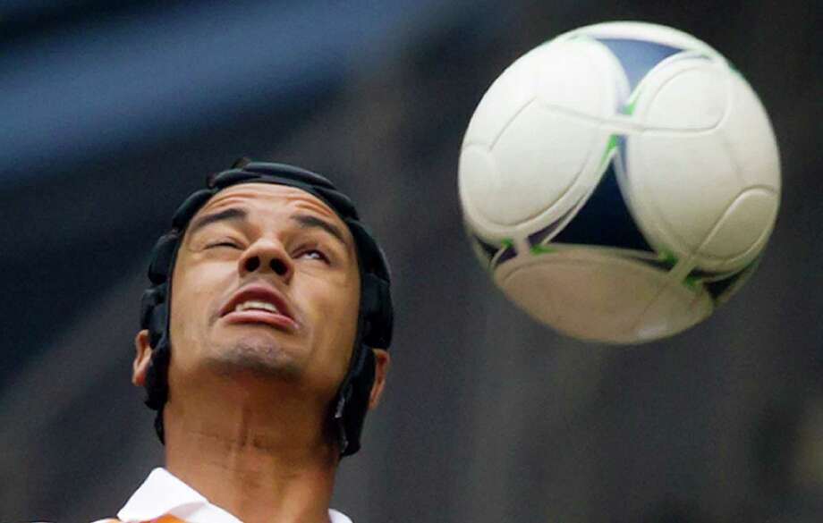 Houston Dynamo's Calen Carr heads the ball during the first half of an MLS soccer game against the Vancouver Whitecaps in Vancouver, British Columbia, on Sunday, June 10, 2012. (AP Photo/The Canadian Press, Darryl Dyck) Photo: Darryl Dyck, Associated Press / The Canadian Press