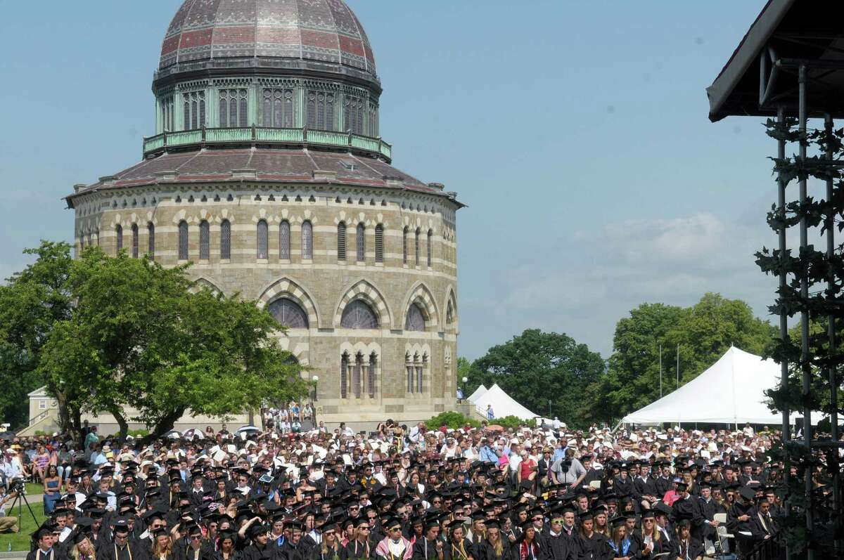 The Nott Memorial is seen in the background as graduates and their family and friends gather for Union College commencement exercises on Sunday, June 10, 2012 in Schenectady, NY. (Paul Buckowski / Times Union)