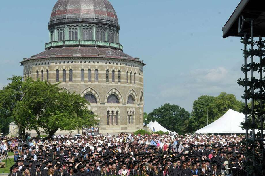 The Nott Memorial is seen in the background as graduates and their family and friends gather for Union College commencement exercises on Sunday, June 10, 2012 in Schenectady, NY.  (Paul Buckowski / Times Union) Photo: Paul Buckowski / 00017204A