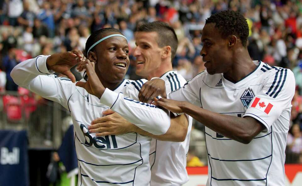 Vancouver Whitecaps' Darren Mattocks, of Jamaica, Sebastien Le Toux, of France, and Gershon Koffie,