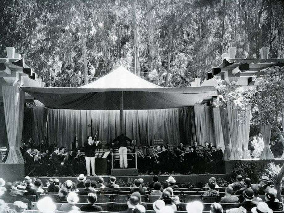 Although the free outdoor music festival at Sigmund Stern Grove would not be inaugurated until 1937, Grove concerts began on June 19, 1932, when the San Francisco Symphony (with violinist Jascha Veissi) gave the first performance there, on a stage beneath a pavilion designed by Bay Area architect Bernard Maybeck. Since then, the Symphony has been an annual feature during Summers at the Grove. Photo credit: Alex Arkatov, courtesy of the Archives for the Performing Arts. Photo: San Francisco Symphony
