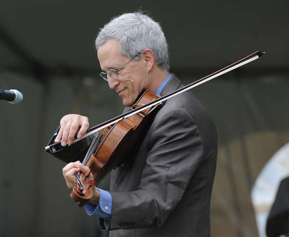Steve Tenenbom on the viola during the Greenwich Kennel Club 80th Dog Show at Taylor Farm Park in Norwalk, Saturday, June 9, 2012. Photo: Bob Luckey / Greenwich Time