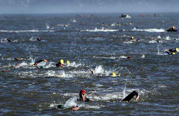 Athletes swim from Alcatraz during the Escape from Alcatraz Triathlon in San Francisco, Calif., Sunday, June 10, 2012.  After completing the 1.5 mile swim, competitors biked 18 miles then ran 8 miles to finish the race. Photo: Sarah Rice, Special To The Chronicle