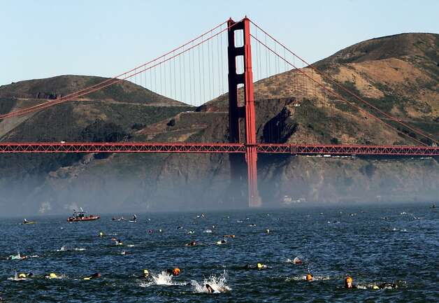 A large group of swimmers overshot the landing spot and ended up swimming a little extra on their way to shore from Alcatraz in the Escape from Alcatraz Triathlon in San Francisco, Calif., Sunday, June 10, 2012.  Boats were in place to try and herd the swimmers back to shore. Photo: Sarah Rice, Special To The Chronicle