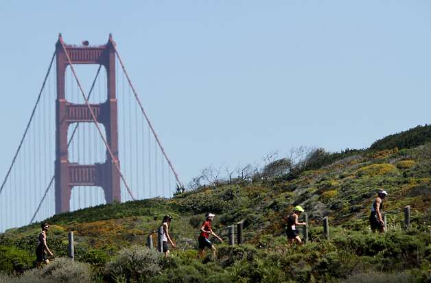 Runners come to the top of the infamous Sand Ladder while competing in the Escape from Alcatraz Triathlon in San Francisco, Calif., Sunday, June 10, 2012.  After swimming 1.5 miles and biking 18 miles, competitors must climb the steps up from the beach as part of their 8 mile run. Photo: Sarah Rice, Special To The Chronicle