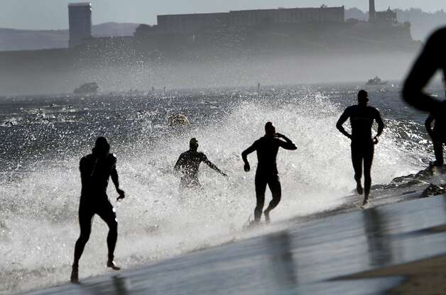 Athletes emerge from the water after swimming from Alcatraz during the Escape from Alcatraz Triathlon in San Francisco, Calif., Sunday, June 10, 2012.  After completing the 1.5 mile swim, competitors biked 18 miles then ran 8 miles to finish the race. Photo: Sarah Rice, Special To The Chronicle