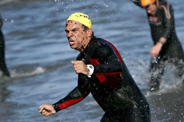 A swimmer completes the first leg of the Escape from Alcatraz Triathlon in San Francisco, Calif., Sunday, June 10, 2012.  After swimming from Alcatraz, athletes bike 18 miles then run 8 miles. Photo: Sarah Rice, Special To The Chronicle