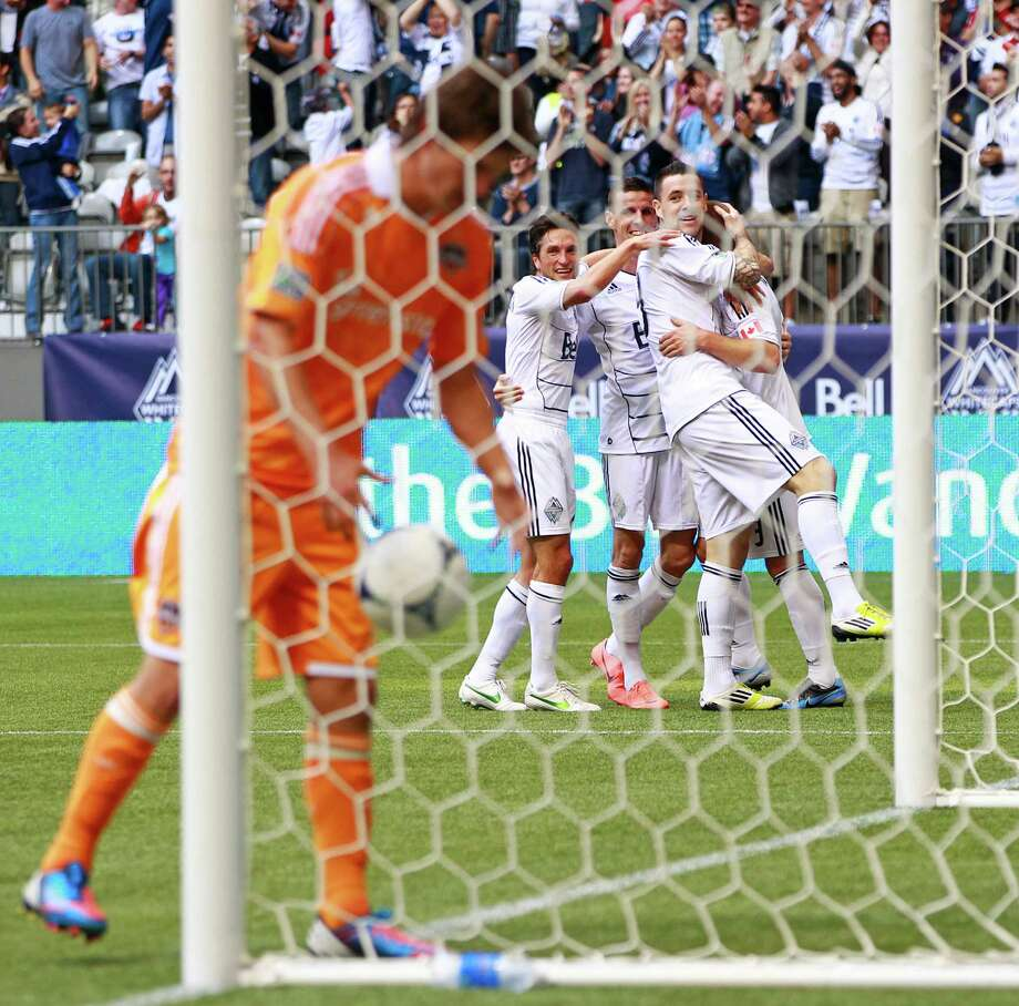 VANCOUVER, CANADA - JUNE 10:  The Vancouver Whitecaps FC celebrate a goal by Jordan Harvey #3 against the Houston Dynamo during their MLS game June 10, 2012 in Vancouver, British Columbia, Canada. Photo: Jeff Vinnick, Getty Images / 2012 Getty Images