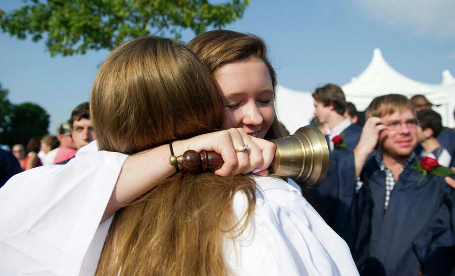 Amanda Nicole Schwartz hugs classmate Riley Jay after the King Class of 2012 commencement exercises on in Stamford, Conn., June 10, 2012. Photo: Keelin Daly / Stamford Advocate