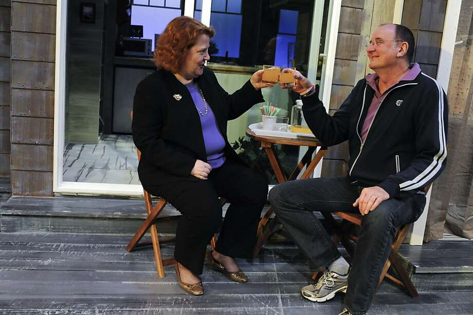 Barbara Hodgen, new executive director of New Conservatory Theatre, toasts with Ed Decker, founding artistic director, at the theater center. Things have changed - a lot - in the organization's 31 years. Photo: Yue Wu, The Chronicle
