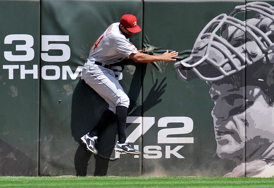 Catcher Carlton Fisk's image gets a close look at Astros outfielder Justin Maxwell's fifth-inning catch during Sunday's win over the White Sox at U.S. Cellular Field. Photo: David Banks / 2012 Getty Images