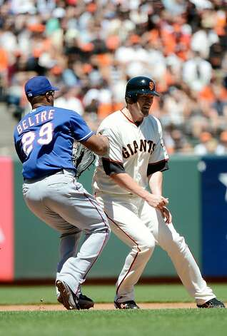 SAN FRANCISCO, CA - JUNE 10:  Aubrey Huff #17 of the San Francisco Giants gets caught in a rundown between second and third and gets tagged out by Adrian Beltre #29 of the Texas Rangers in the six inning at AT&T Park on June 10, 2012 in San Francisco, California.  (Photo by Thearon W. Henderson/Getty Images) Photo: Thearon W. Henderson, Getty Images