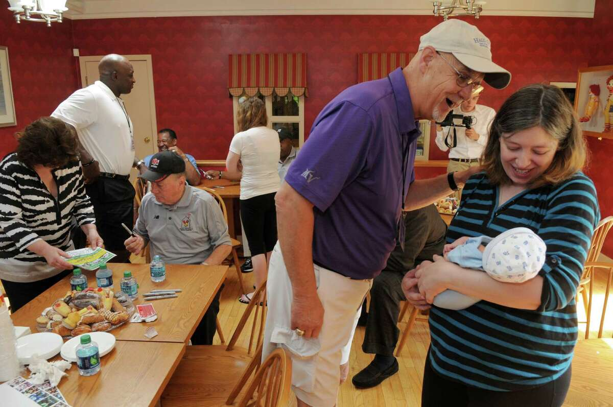NFL Hall of Famer Paul Krause looks at Phoenix, a 10 day old boy who just had intestinal surgery, held by his mother Kerry Simmons of Columbus, NY, during a visit to the Ronald McDonald House on Sunday June 10, 2012 in Albany, NY. (Philip Kamrass / Times Union)