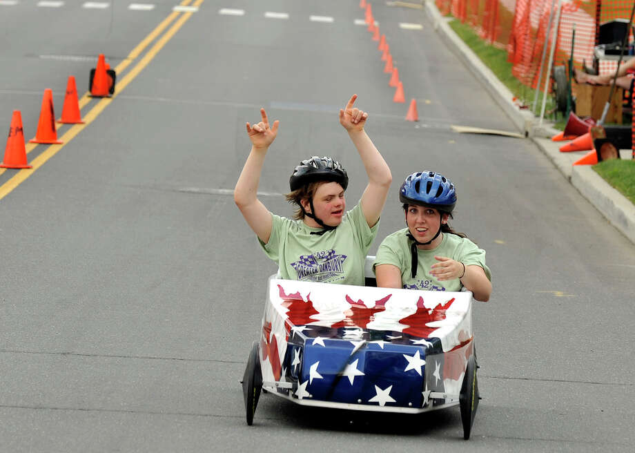 Jack Johnson, 16, of Danbury, and Megan Strand, 20, of New Milford, cross the finish line to win their race in the Danbury Soap Box Derby Sunday, June 10, 2012. Photo: Michael Duffy