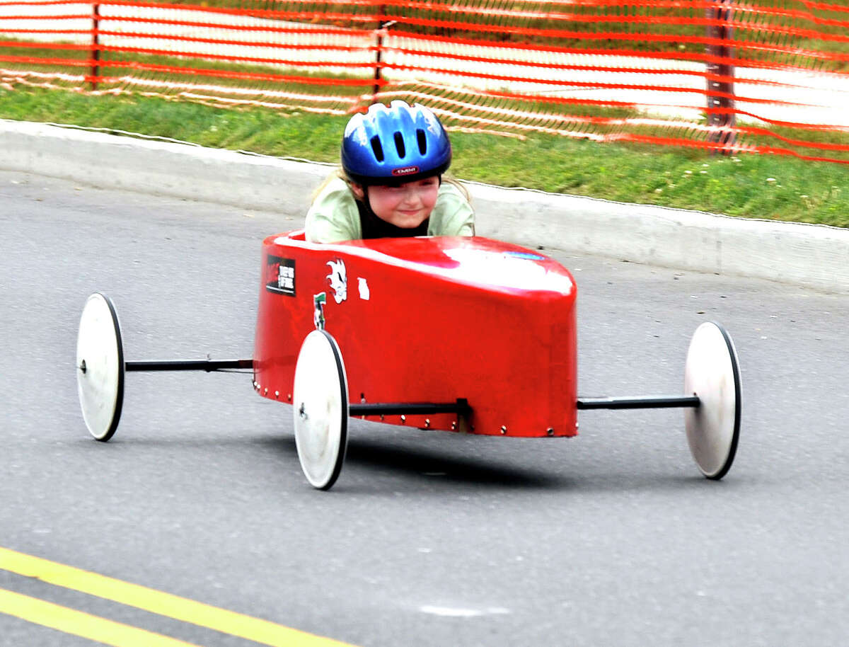 Katie Yeargin, 8, of Brookfield races to the finish line in the Danbury Soap Box Derby Sunday, June 10, 2012.