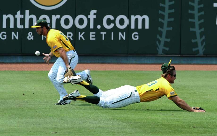 Baylor's Logan Vick, left, and Dan Evatt, right, try for a double by Arkansas' Joe Serrano in the first inning of an NCAA college baseball tournament super regional game on Sunday, June 10, 2012, in Waco. Photo: AP Photo/Waco Tribune Herald, Rod Aydelotte