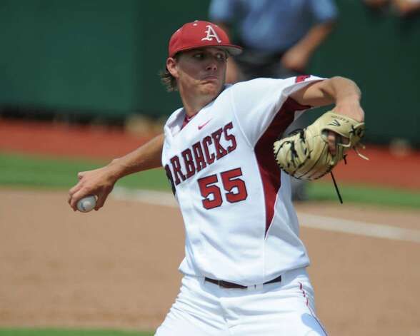 Arkansas starting pitcher Tyne Stanek throws against Baylor in the first inning of an NCAA college baseball tournament super regional game on Sunday, June 10, 2012, in Waco. Photo: AP Photo/Waco Tribune Herald, Rod Aydelotte