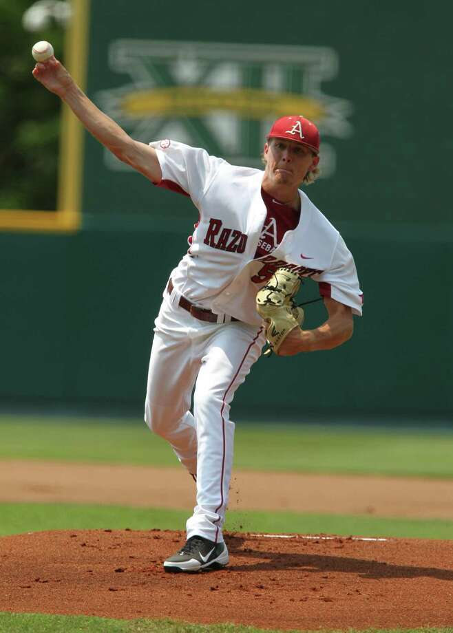Arkansas starting pitcher Tyne Stanek throws from the mound against Baylor in the first inning of an NCAA college baseball tournament super regional game on Sunday, June 10, 2012, in Waco. Photo: AP Photo/Waco Tribune Herald, Jerry Larson