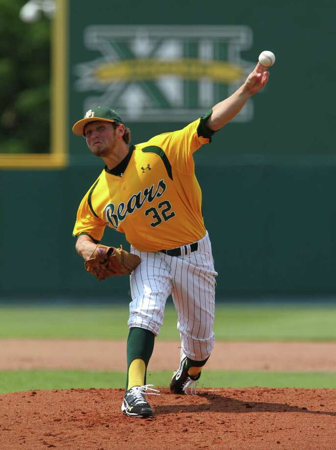 Baylor starting pitcher Josh Turley throws from the mound against Arkansas in the first inning of an NCAA college baseball tournament super regional game on Sunday, June 10, 2012, in Waco. Photo: AP Photo/Waco Tribune Herald, Jerry Larson