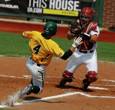 Arkansas catcher John Clay Reeves, right, tags out Baylor's Nathan Orf (4) in the third inning of an NCAA college baseball tournament super regional game on Sunday, June 10, 2012, in Waco. Photo: AP Photo/Waco Tribune Herald, Jose Yau