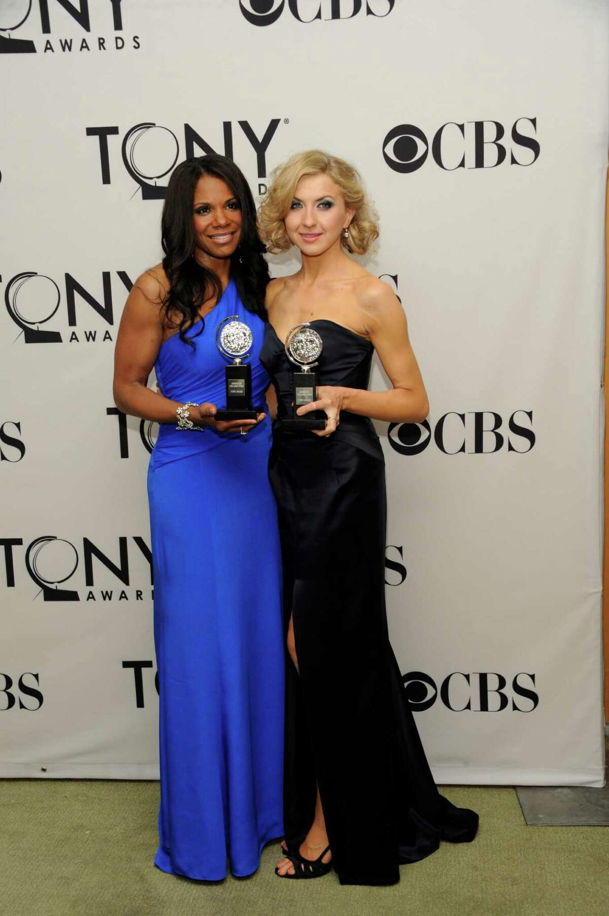 Audra McDonald, left, and Nina Arianda pose with their awards at the 66th annual Tony Awards on Sunday June 10, 2012, in New York. (Photo by Evan Agostini /Invision/AP)