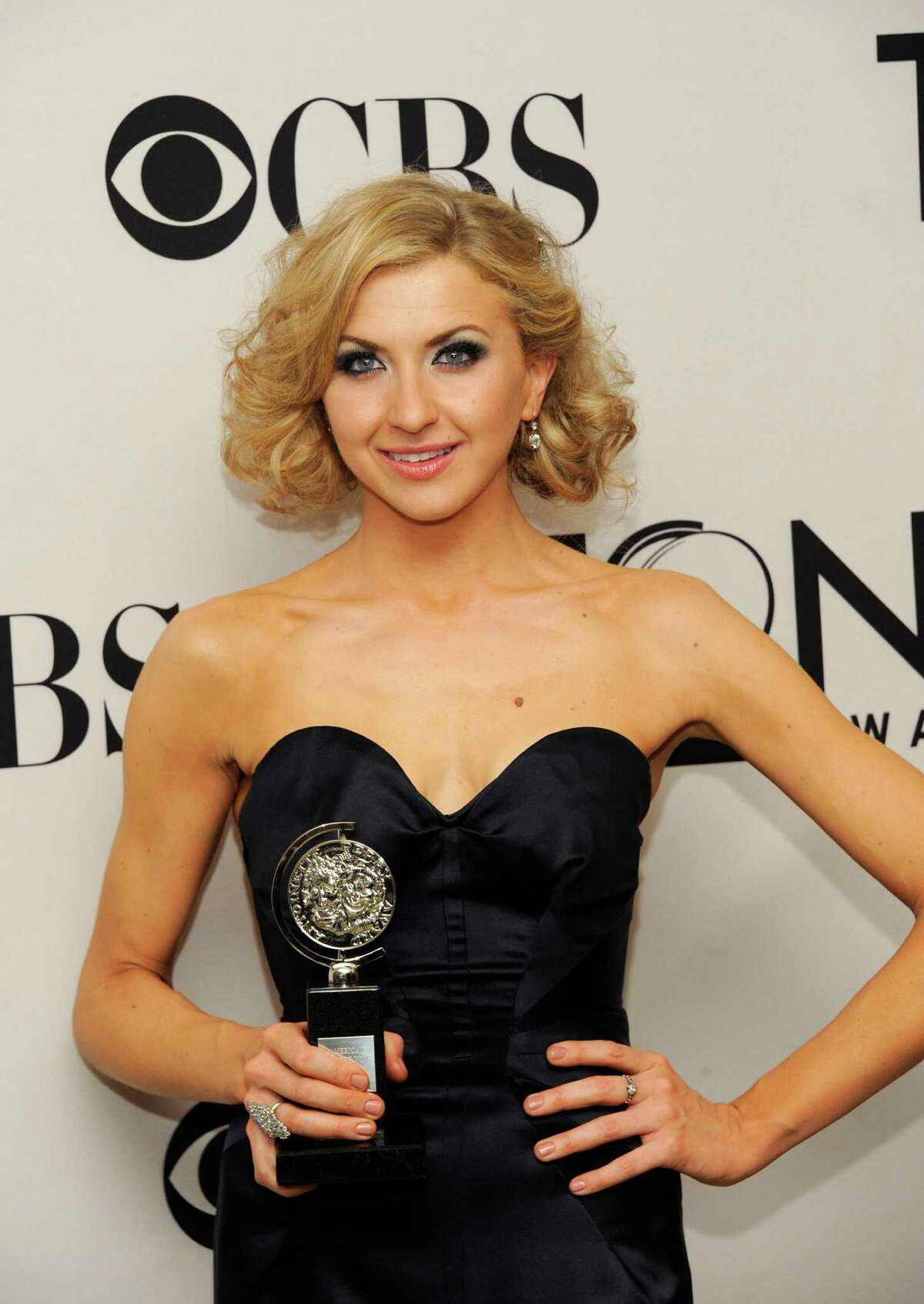 Nina Arianda poses backstage with her award at the 66th annual Tony Awards on Sunday June 10, 2012, in New York. (Photo by Evan Agostini /Invision/AP)