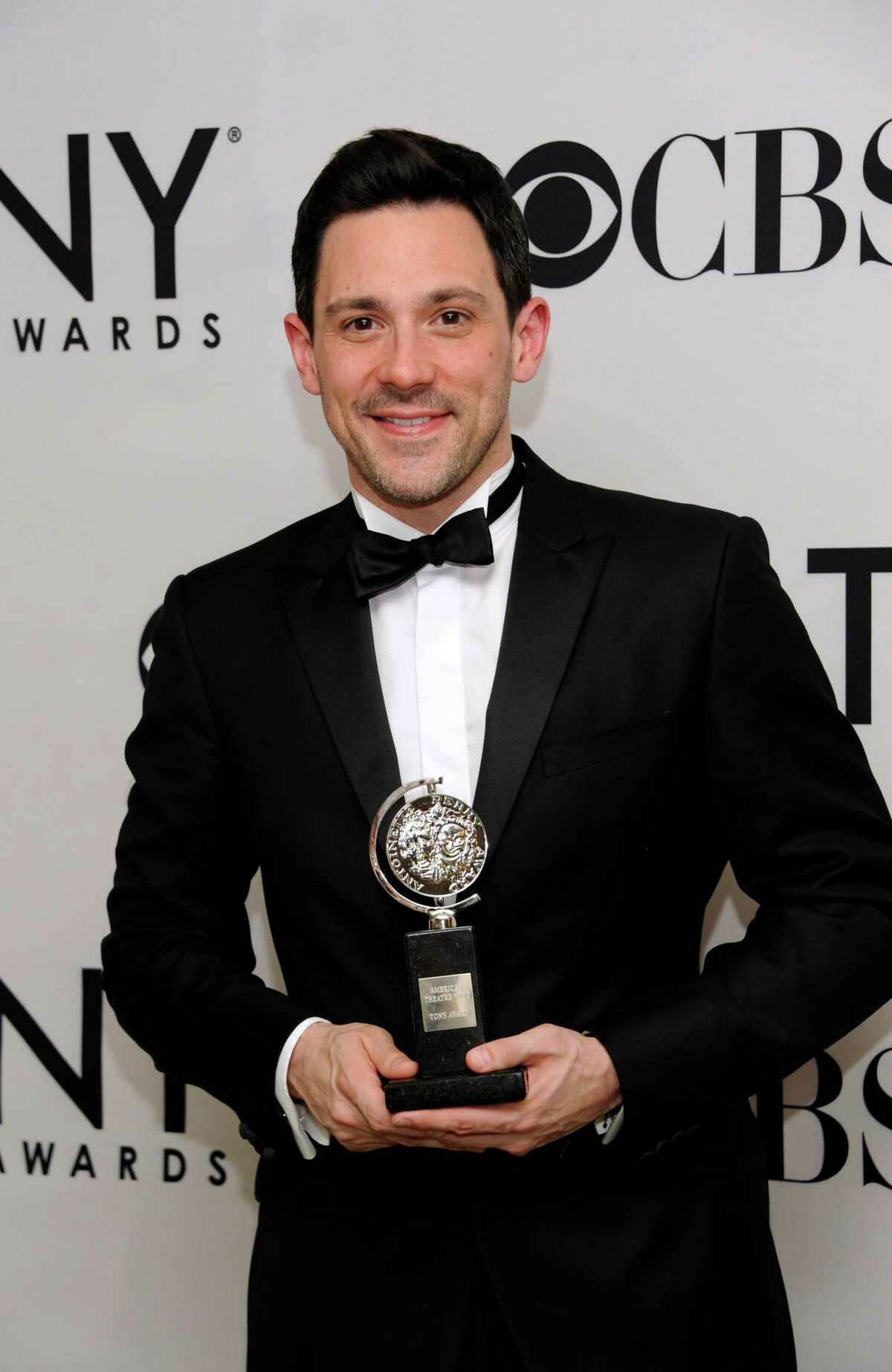 Steve Kazee poses backstage with his award at the 66th annual Tony Awards on Sunday June 10, 2012, in New York. (Photo by Evan Agostini /Invision/AP)