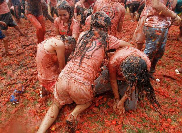 "People participate in the sixth annual tomato fight festival called ""tomatina"" in Sutamarchan, some 71 miles northeast of Bogota, Colombia, Sunday, June 10, 2012. Photo: Associated Press"