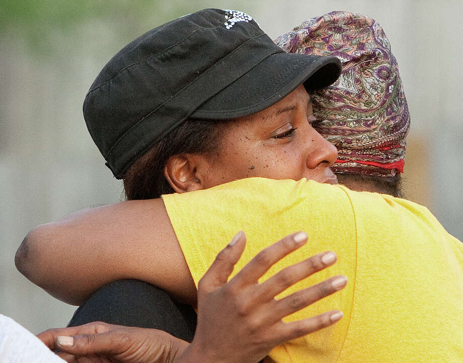 Andrea Landry, left, is comforted by Crystal Jean, right, after Landry's mother's body was found dead in the 5400 block of Chennault Street Monday, June 11, 2012, in Houston. Photo: Cody Duty, Houston Chronicle / © 2011 Houston Chronicle