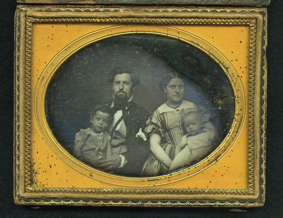 This image provided by the Museum of the Confederacy shows an Ambrotype photo of an unidentified soldier, who left this image of himself with Mrs. L.M.C. Lee of Corinth, Mississippi, on the eve of the battle of Shiloh. The soldier never reclaimed his image and was presumed to have been killed in battle. The Museum of the Confederacy is publicly releasing eight images recovered on battlefields of unidentified persons in the admittedly remote chance a descendant might recognize a facial resemblance or make a connection the battlefields where they were found. (AP Photo/The Museum of the Confederacy) Photo: Museum Of The Confederacy, Associated Press / Museum of the Confederacy