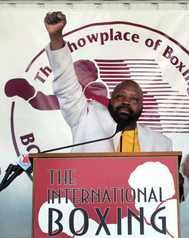 "Mark ""Too Sharp"" Johnson pumps his fist after accepting his induction into the International Boxing Hall of Fame during the induction ceremony in Canastota, N.Y., Sunday, June 10, 2012. Photo: Heather Ainsworth, AP / AP"