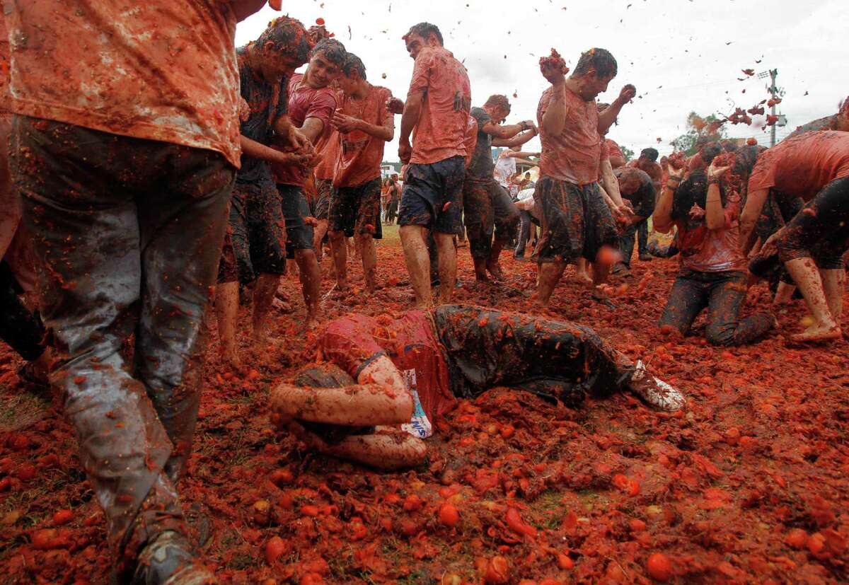 People participate in the sixth annual tomato fight festival called