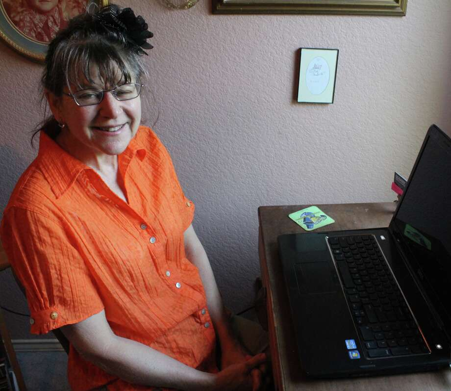 Castle Hills-area resident Cindy M. Callins is not letting her battle with cancer to interfere much with her budding career as a novelist. Photo: Melody C Mendoza / North Central News