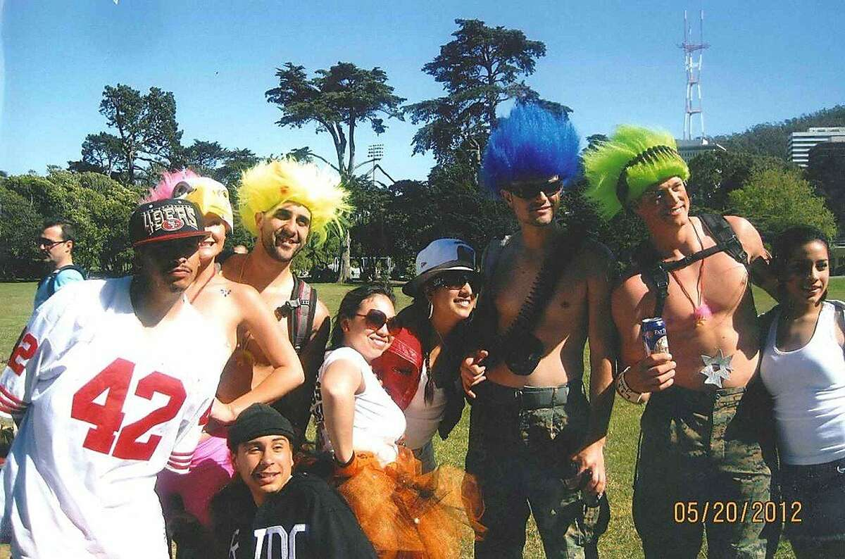 Stephen Martin, at right in the green wig, with friends and members of a group that included a man who later punched Martin, causing him to hit his head on the ground and lose consciousness. Martin never recovered from the post-Bay to Breakers attack May 20, 2012, and died June 8, 2012.