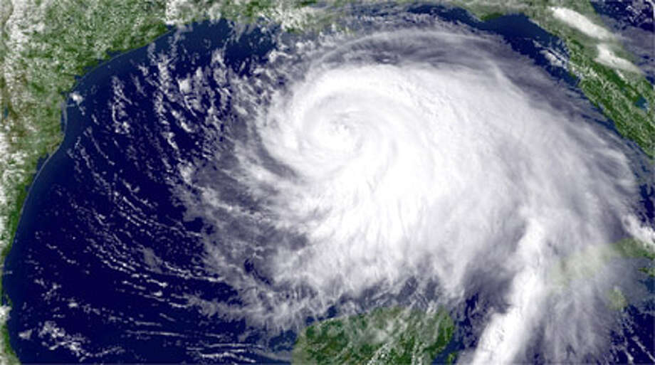 IN SPACE - SEPTEMBER 11:  In this handout from the National Oceanic and Atmospheric Administration (NOAA), Hurricane Ike appears as a large and powerful storm as it churns in the Gulf of Mexico September 11, 2008. Hundreds of thousands of people on the Texas coastline have reportedly fled as Ike moves toward the coast. Photo: Handout, . / Getty Images North America