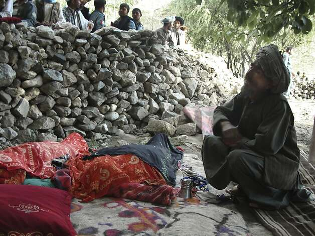 An Afghan man mourns the death of relatives near the site after an earthquake hit Baghlan province, north of Kabul, Afghanistan, Monday, June 11, 2012. As many as 100 people are feared dead after an earthquake struck northern Afghanistan this morning. The governor of Baghlan province says the quake triggered a landslide that buried a remote village under mud and rocks. He says rescuers have so far pulled two bodies from the rubble, while the U.N. confirms one other death. The world body says houses were destroyed across five districts in all. (AP Photo/Jawed Basharat) Photo: Jawed Basharat, Associated Press