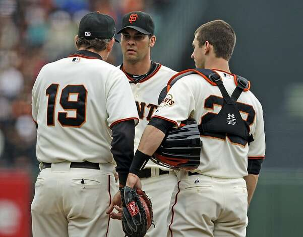 San Francisco Giants starting pitcher Ryan Vogelsong, center, talks to pitching coach Dave Righetti, left, and catcher Buster Posey after giving up two runs to the Chicago Cubs during the second inning of a baseball game in San Francisco, Monday, June 4, 2012. (AP Photo/Marcio Jose Sanchez) Photo: Marcio Jose Sanchez, Associated Press