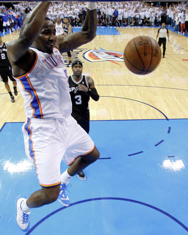 Oklahoma City Thunder center Kendrick Perkins (5) dunks against the San Antonio Spurs during the second half of Game 6 in the NBA basketball Western Conference finals, Wednesday, June 6, 2012, in Oklahoma City. The Thunder won 107-99 and move on to the NBA Finals. (AP Photo/Sue Ogrocki) Photo: Sue Ogrocki, STF / AP