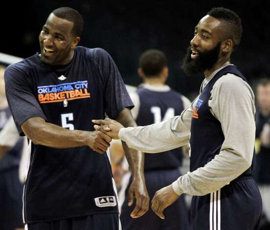 Oklahoma City Thunder center Kendrick Perkins (5) and James Harden joke around during practice, Monday, June 11, 2012, in Oklahoma City. Game 1 of  NBA finals basketball between the Miami Heat and Thunder is Tuesday. (AP Photo/Jeff Roberson) Photo: Jeff Roberson, STF / AP