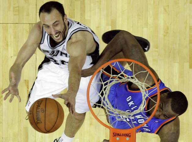 San Antonio Spurs' Manu Ginobili, left, of Argentina, is defended by Oklahoma City Thunder's Kendrick Perkins during the second half of Game 5 in the NBA basketball Western Conference finals, Monday, June 4, 2012, in San Antonio. The Thunder won 108-103. (AP Photo/Eric Gay) Photo: Eric Gay, STF / AP