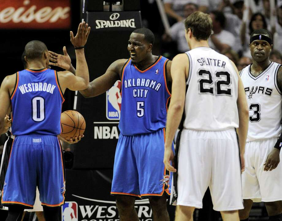 Oklahoma City Thunder point guard Russell Westbrook (0) and center Kendrick Perkins (5) react after a play against San Antonio Spurs center Tiago Splitter (22), of Brazil, and shooting guard Stephen Jackson (3) during the second half of Game 5 in the NBA basketball Western Conference finals, Monday, June 4, 2012, in San Antonio. (AP Photo/Darren Abate) Photo: Darren Abate, FRE / FR115 AP