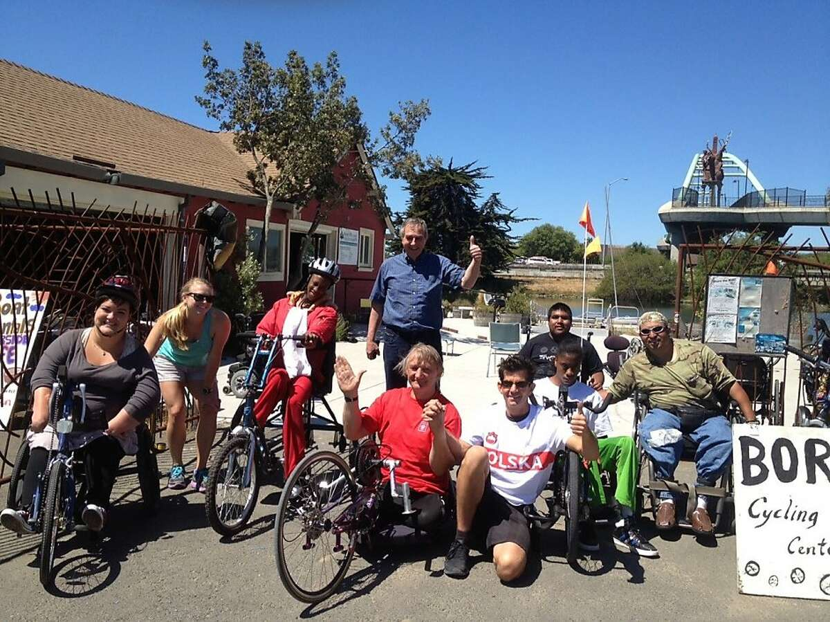 Krzysztof Jarzebski, center, in red shirt, with members of his support team and the Bay Area Outreach and Recreation Program, which loaned the Paralympic athlete a hand-cranked bicycle to replace one stolen in San Francisco on June 8, 2012.