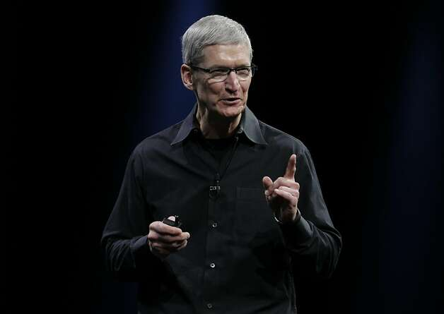 Apple CEO Tim Cook  at the Apple Developers Conference in San Francisco, Monday, June 11, 2012. (AP Photo/Paul Sakuma) Photo: Paul Sakuma, Associated Press