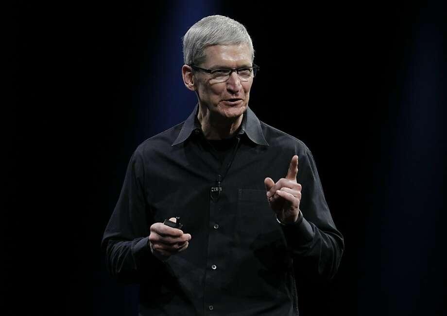 Apple CEO Tim Cook  at the Apple Developers Conference in San Francisco, Monday, June 11, 2012. (AP Photo/Paul Sakuma) Photo: Paul Sakuma, Associated Press