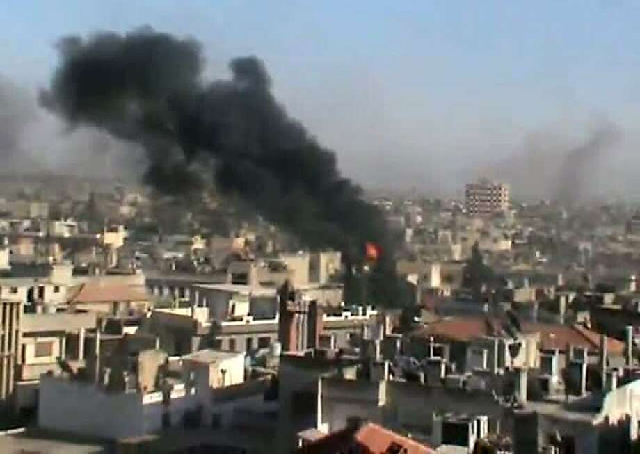 "An image grab taken from a video uploaded on YouTube on June 11, 2012 shows smoke billowing from the flashpoint Syrian city of Homs which activists said was being attacked by regime forces. UN-Arab League envoy Kofi Annan said he is gravely concerned by increased fighting between Syria's troops and rebel forces as violence killed dozens of people across the country. AFP PHOTO/YOUTUBE  == RESTRICTED TO EDITORIAL USE - MANDATORY CREDIT ""AFP PHOTO / HO / YOUTUBE"" - NO MARKETING NO ADVERTISING CAMPAIGNS - DISTRIBUTED AS A SERVICE TO CLIENTS - AFP IS USING PICTURES FROM ALTERNATIVE SOURCES AS IT WAS NOT AUTHORISED TO COVER THIS EVENT, THEREFORE IT IS NOT RESPONSIBLE FOR ANY DIGITAL ALTERATIONS TO THE PICTURE'S EDITORIAL CONTENT, DATE AND LOCATION WHICH CANNOT BE INDEPENDENTLY VERIFIED  ==-/AFP/GettyImages Photo: -, AFP/Getty Images"