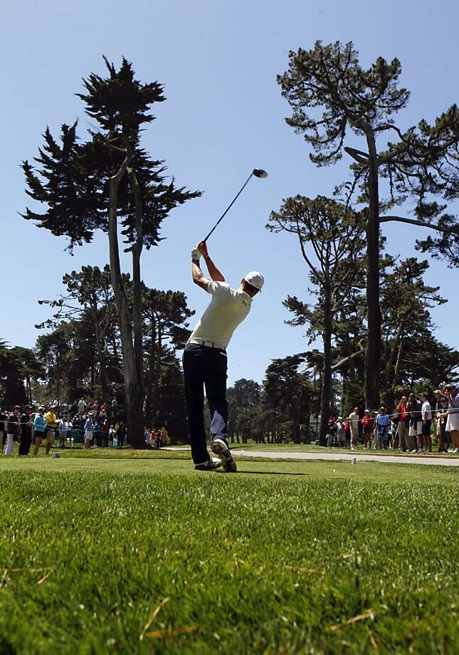 Martin Kaymer threads his tee shot between two very tall trees on the par-5 sixteenth hole, as the first day of practice rounds gets underway during the United States Open Championship at the Olympic Club in San Francisco, Ca., on Monday June 11, 2012. Photo: Michael Macor, The Chronicle