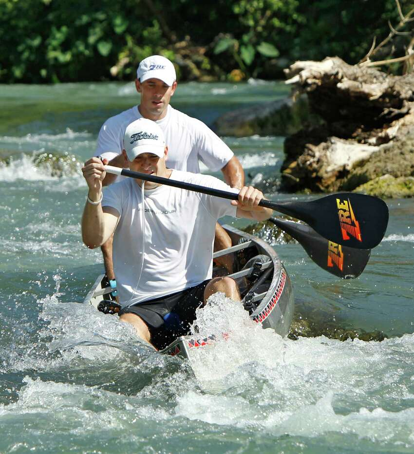 Brad Ellis, 30 (front), and Ian Rolls, 34, paddle through Cottonseed Rapids in Martindale on Saturday morning, June 9, 2012, after the start of the 2012 Texas Water Safari. Ellis died Monday, June 11, 2012 at San Antonio Military Medical Center in San Anotnio of complications due to hyponatremia, an electrolyte disturbance in the body. He was airlifted out of Gonzales County early Sunday morning after race officials were notified that Ellis was having problems. The 260-mile race dubbed the