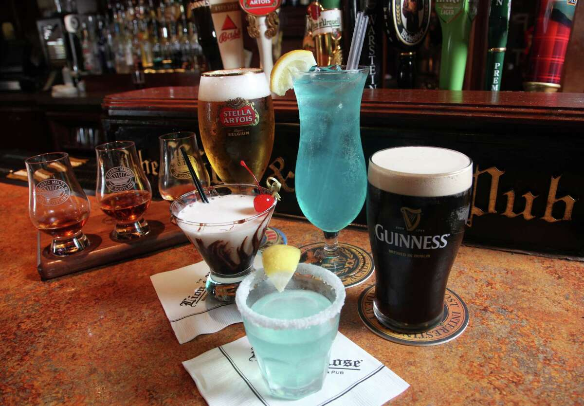 LION AND ROSE drinks Blue Eyed FLoozy (small blue shooter), Maui Waui (tall blue drink) Chocolatini (Martini drink) Guinness Strout, Stella Artois, Scotch Flight ( 3 small glasses on board) May 24, 2012 Juanito M. Garza/San Antonio Express-News